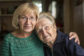 An elderly lady with her carer.